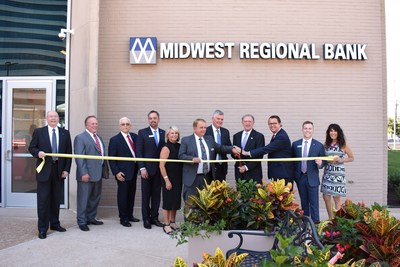 Pictured L-R: Director Joe Simmens, Vice-Chairman Nelson Scherrer, Director Dr. Steven D. Crawford, Exec VP Mike Taylor, Interior Designer Diane Bender, Chairman and CEO Michael F. Bender, Area President Sanford Scott, Clayton Mayor Harold Sanger, Bank President Tyler Bender, VP Brad McLaury, Chamber Exec Director Ellen Gale