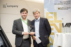 Founder and CEO of kompany, Russell E. Perry shakes hands with RBI CEO, Dr. Johann Strobl (PRNewsfoto/360kompany GmbH)