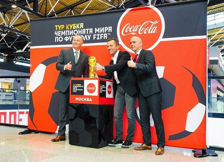 Sheremetyevo Chairman of the Board Alexander Ponomarenko, Lothar Matthäus, and Mikael Vine with the FIFA World Cup Trophy.