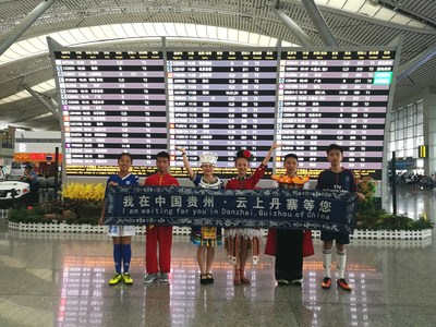 Six Flag Bearers from Danzhai at the airport