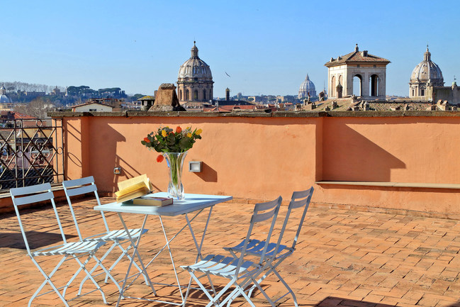 Rooftop view of the St. Peter's Basilica dome, which architect Giacomo della Porta completed after Michelangelo died.