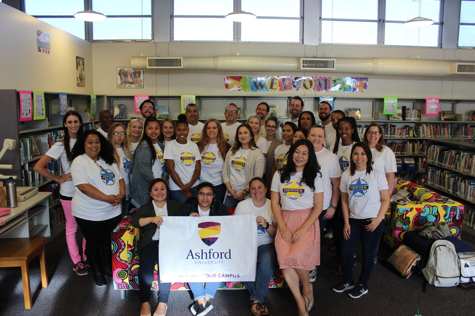 """Volunteers from Bridgepoint Education and Ashford University at Foster Elementary in San Diego for JA """"Teach Day."""""""