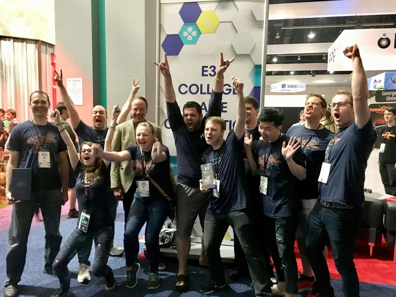 Mike Gallagher, CEO of ESA, celebrates with Brigham Young University video game team, winners of The E3 College Game Competition, for their game, Beat Boxers. Los Angeles, June 14, 2018.