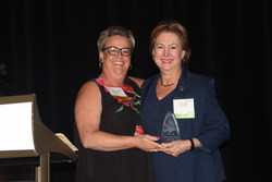 Flynann Janisse, executive director of Rainbow, presenting Kim Ogg, Harris County District Attorney, with the Community Partner of the Year award