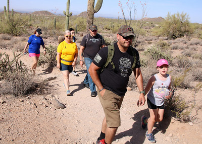 Injured veterans and their guests empowered each other as they hit a rough hiking trail near Usery Mountain's Wind Cave during a recent Wounded Warrior Project® event