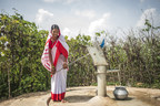 Binan Devi, 30, uses a new hand pump to collect clean water that she uses in her home in Bihar, northern India. With PepsiCo's funding to Water Aid, similar hand pumps are now being installed in water-stressed southern India villages. (WaterAid/ Poulomi Basu)