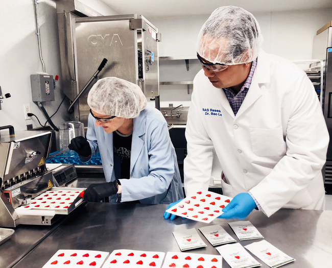 Dr. Bao Le, CEO, BAS Research, and Meghan Muckenfuss, co-founder of Dr. Raw Organics, formulate cannabis-infused pomegranate-mango candy Relax Hearts (1:20 CBD:THC)