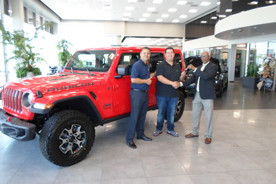 Christian Castro (center), winner of the FCA 2017 National Sweepstakes, receives the keys to his All-new 2018 Jeep Wrangler Rubicon, from (left) General Sales manager Abel Salazar (Champion Chrysler Dodge Jeep Ram of Downey, Calif.) and John Robinson (right).