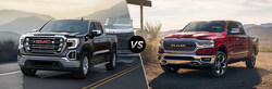The 2019 GMC Sierra is compared against the 2019 Ram 1500.