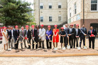 Corporate executives and District officials celebrate the groundbreaking of Stevens Place and Stevens School