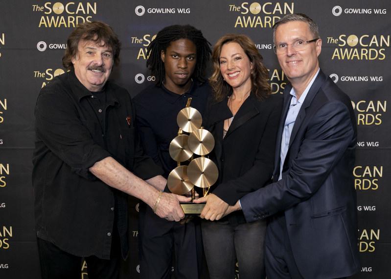 Left to right: SOCAN Lifetime Achievement Award Winner Burton Cummings;  Breakout Artist Award Winner Daniel Caesar;  Global Inspiration Award Winner Sarah McLachlan; and SOCAN CEO Eric Baptiste (CNW Group/SOCAN)