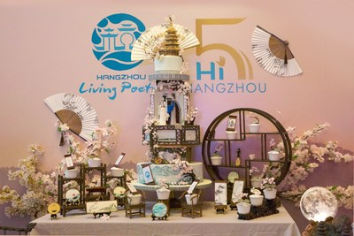 The birthday-themed cake takes the shape of Hangzhou's signature landmarks and folktales