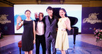 Piano megastar Lang Lang gesturing a high five with his young scholars