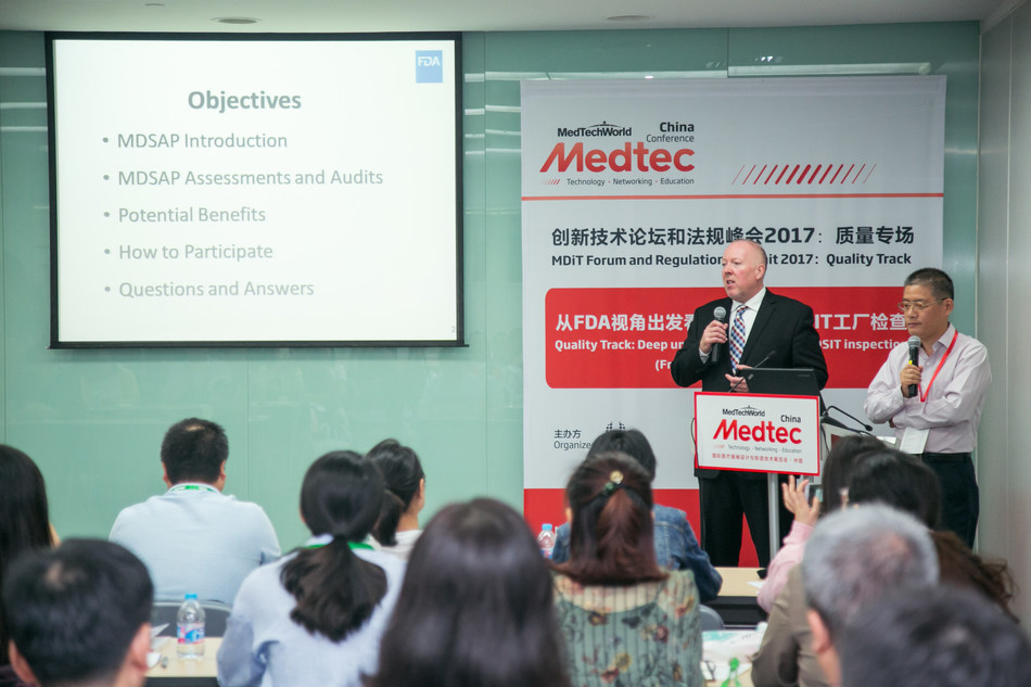 FDA Assistant Country Director of China William M. Sutton is speaking at a meeting.