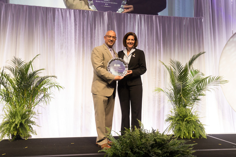 Lou Holland Jr presents Sen. Catherine Cortez Masto (D-Nev.) with the Alzheimer's Impact Movement Humanitarian Award. Photo Credit: Alzheimer's Association