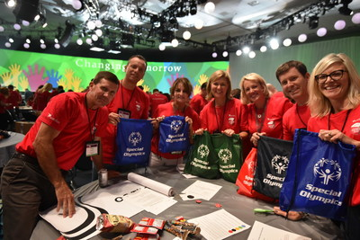 Astellas employees create bags to be used at upcoming Special Olympics of Southern California summer games.