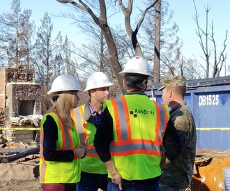 AshBritt CEO Brittany Perkins, left, discussing clean-up operations with employees from AshBritt and the U.S. Army Corps of Engineers.