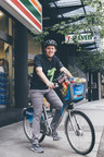 Doug Rosencrans, 7-Eleven Canada's Vice President and General Manager, fills his Mobi bike with better-for-you food and drink in downtown Vancouver (CNW Group/7-Eleven Canada)