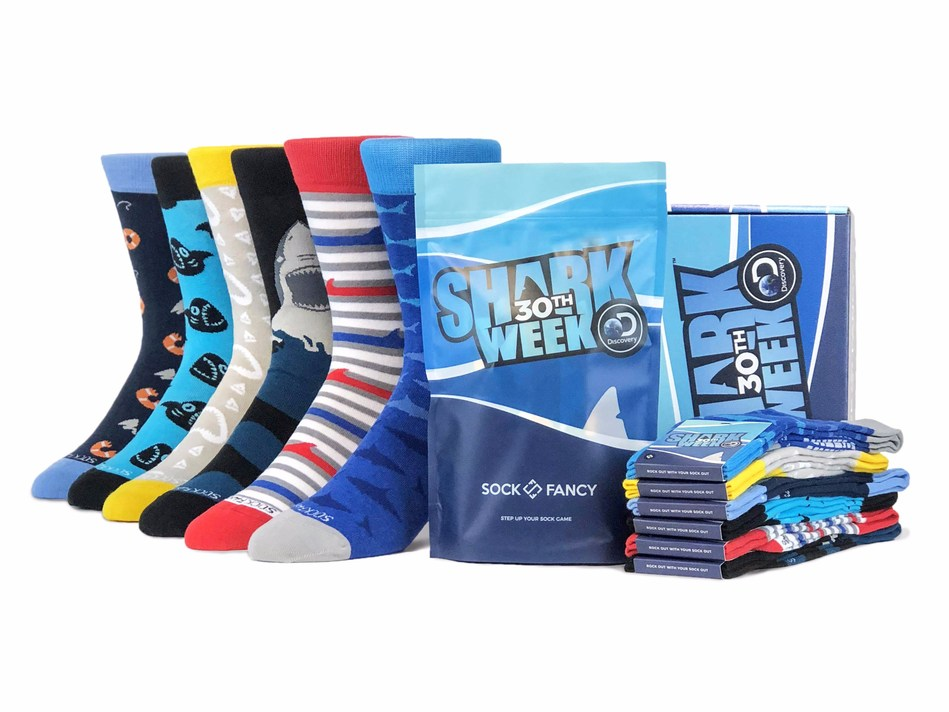 The official Sock Fancy x Discovery Shark Week collection featuring six shark inspired designs, each showcasing iconic summer themes .