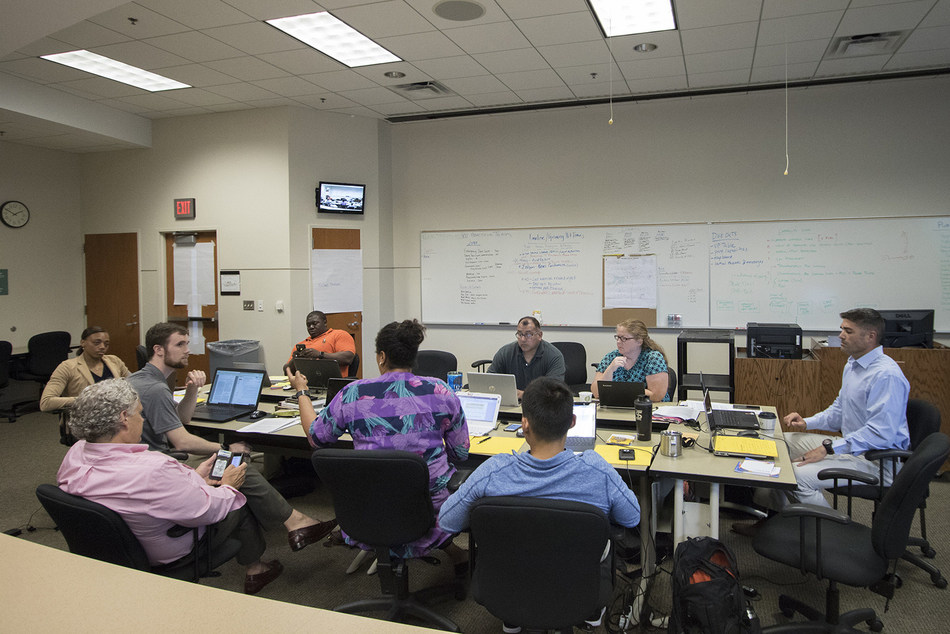 Homeland security master's students formulate an emergency plan for a long-term blackout during their simulation-style practicum July 18 at the KU Edwards Campus in Overland Park.