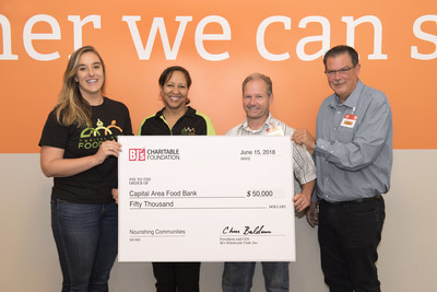 Scott Thomas, general manager, BJ's Wholesale Club in Bowie (right) presents a $50,000 donation from the BJ's Charitable Foundation to Andrea Kippur, Foundation Relations Manager (left) and Christel Hair, Senior Director of Strategic Partnership and Community Engagement (second from left) of the Capital Area Food Bank to support their Hunger-Free Summer Programs.