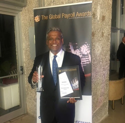 Victor Lobo, Chief Revenue Officer for Blue Marble, accepts Global Payroll award during ceremony in Lisbon, Portugal.