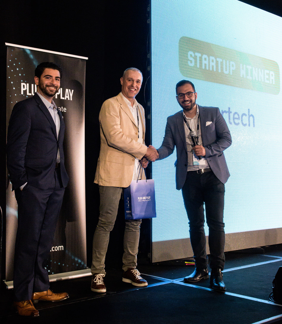 Attila Toth, Founder & CEO of zesty.ai receives the People's Choice Award for Most Innovative Insurtech Startup from Ali Safavi, Global Head of Insurtech and Hutch Moragne, Corporate Partnerships Manager at Plug And Play