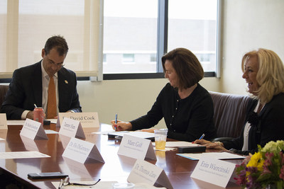 David Cook, vice chancellor of the KU Edwards Campus, Tammy Ham, president of BioNOVUS Innovations, and Marc Goff, chief executive officer of Behavioral Health Holdings, sign a proclamation on June 21 at the KU Edwards Campus in Overland Park, solidifying a unique private-public collaboration that provides an innovative applied behavior analysis practicum program.