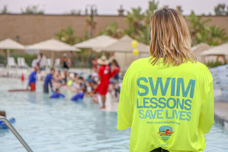 An Estimated 45,000 Children from Twenty-Nine Countries on Six Continents Kick Off First Day of Summer with the World's Largest Swimming Lesson™ (#WLSL) to Combat Childhood Drowning.