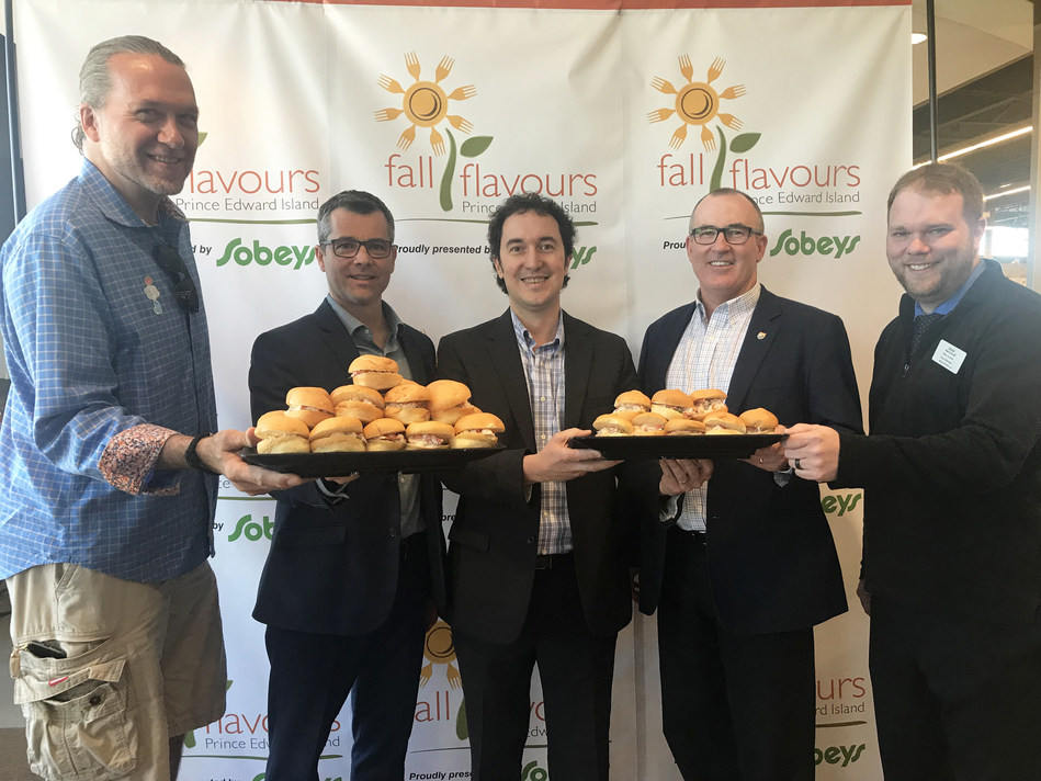"""Serving up Lobster Rolls at Sobeys Extra in Stratford to celebrate big announcements for Fall Flavours"" (Left to Right) Chef Michael Smith (PEI Food Ambassador), Michael MacKinnon (Atlantic Lottery), John Rowe (Food Island Partnership), The Honourable Chris Palmer (Minister of Economic Development and Tourism), Matt Gauthier (Sobeys Extra Stratford Store Manager) (CNW Group/Fall Flavours Culinary Festival)"