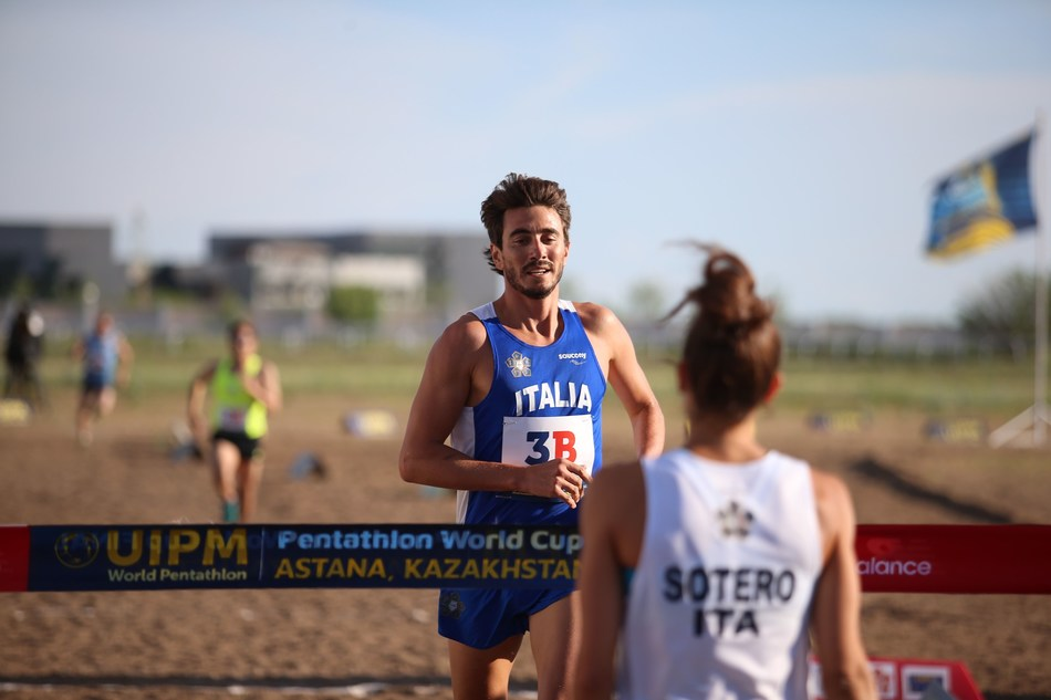 Riccardo de Luca crosses the finish line as his partner Alice Sotero waits to celebrate their victory in the Mixed Relay at the UIPM 2018 Pentathlon World Cup Final in Astana, Kazakhstan (PRNewsfoto/UIPM)