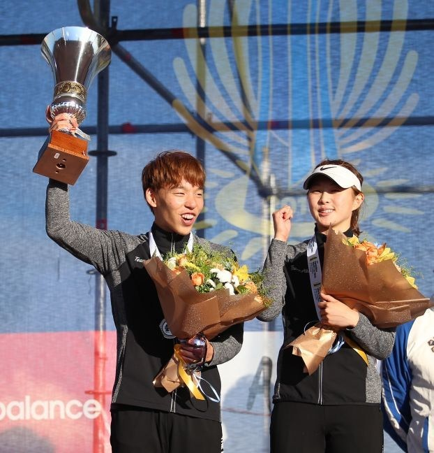 Lee Jihun and Kim Sunwoo celebrate with their trophy, silver medals and flowers after finishing second in the Mixed Relay at the UIPM 2018 Pentathlon World Cup Final in Astana, Kazakhstan (PRNewsfoto/UIPM)