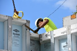 Superior Walls employee works on installation of a precast concrete wall foundation. The U.S.A. company expects to manufacture and install 6,000 systems in 2018.