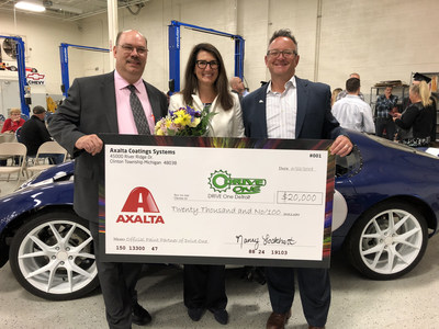 From left to right: Paul Tregembo Jr., Drive One Director, Nancy Lockhart, Axalta Color Marketing Manager, and John Wray, Axalta OEM Global Marketing Manager. Lockhart presented the school with a check and informed the students that Axalta will also supply professional bodyshop equipment including Cromax EZ, spray guns, safety equipment, and more.
