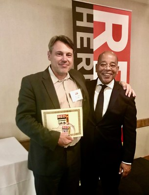 Nuvve's CEO Gregory Poilasne (left) receives award from Alex Vieux Chairman of Red Herring (right).