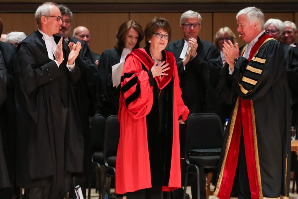 The Honourable Eleanore A. Cronk (centre) is congratulated by members of the Bar and Bench after receiving an honorary LLD from the Law Society of Ontario at the morning Call to the Bar ceremony on June 26, 2018 at Roy Thomson Hall in Toronto. Justice Cronk received the honorary LLD in recognition of her numerous contributions to the profession and the Bench. Shown here are The Honorable George R. Strathy, Chief Justice of Ontario (left) and Paul Schabas, Treasurer of the Law Society of Ontario (CNW Group/The Law Society of Ontario)