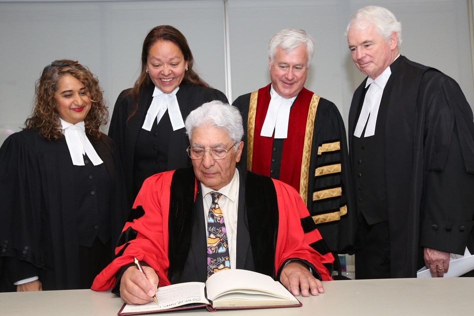 The Honourable Leonard S. Mandamin (centre) signs the Law Society of Ontario's Honorary LLD Register at the Call to the Bar ceremony on June 26, 2018 in Toronto. He received the honorary degree from the Law Society for his work as a highly respected and dedicated leader within the legal profession and the Indigenous community. Left to right: Law Society Benchers Isfahan Merali and Dianne Corbiere, Treasurer Paul Schabas and The Honourable Paul S. Rouleau, Court of Appeal for Ontario. (CNW Group/The Law Society of Ontario)