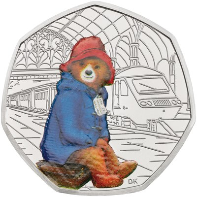 The Royal Mint has revealed two new limited edition Paddington Bear coins to celebrate the 60th anniversary of Paddington Bear's first adventure in A Bear Called Paddington