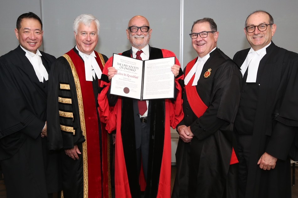 Members of the Bar and Bench congratulate Reuben Rosenblatt, Q.C., LSM (centre), on receiving an honorary LLD from the Law Society of Ontario (LSO) on June 27. He received the degree in recognition of his legendary accomplishments and his contributions to the real estate bar — and for his gift as a legal educator. Left to right: LSO Bencher Jeffrey Lem; LSO Treasurer Paul Schabas; The Honourable Geoffrey Morawetz, Regional Senior Judge, Toronto Region; and LSO Bencher Sidney Troister, LSM. (CNW Group/The Law Society of Ontario)