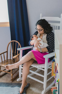 Military spouse and rocker recipient from the inaugural Operation Rocker program in 2016 enjoys time with her newborn baby shortly after receiving her rocker.