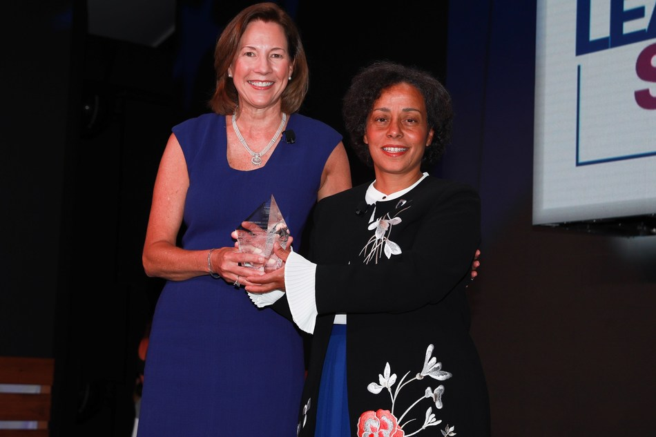KPMG U.S. Chairman and CEO Lynne Doughtie (left) presents retired Four-Star U.S. Navy Admiral Michelle Howard (right) with the 2018 KPMG Inspire Greatness Award at the KPMG Women's Leadership Summit.