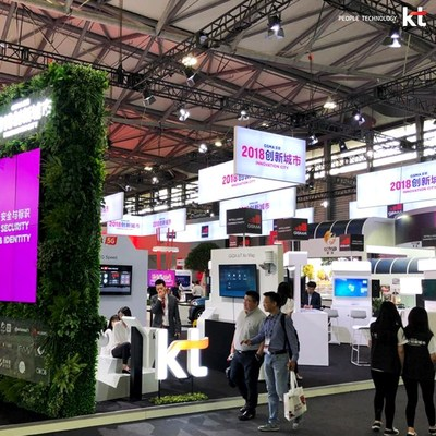 People visit KT's booth at the Mobile World Congress Shanghai 2018 on June 27.