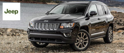 Car shoppers near Houston can find a selection of used Jeep and used Kia models, like the Jeep Compass in this photo, at the Coast to Coast Motors used dealership.