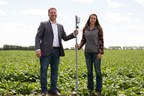 Stuart Cullum, President of Olds College and Catalina Oitzl, current Olds College Student plant a soil and crop evaluation sensor into the Olds College Smart Farm (CNW Group/Olds College)