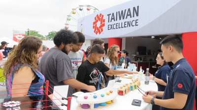 Spectators and concertgoers at Summerfest 2018 review the numerous products at the Taiwan Excellence Experience Zone.