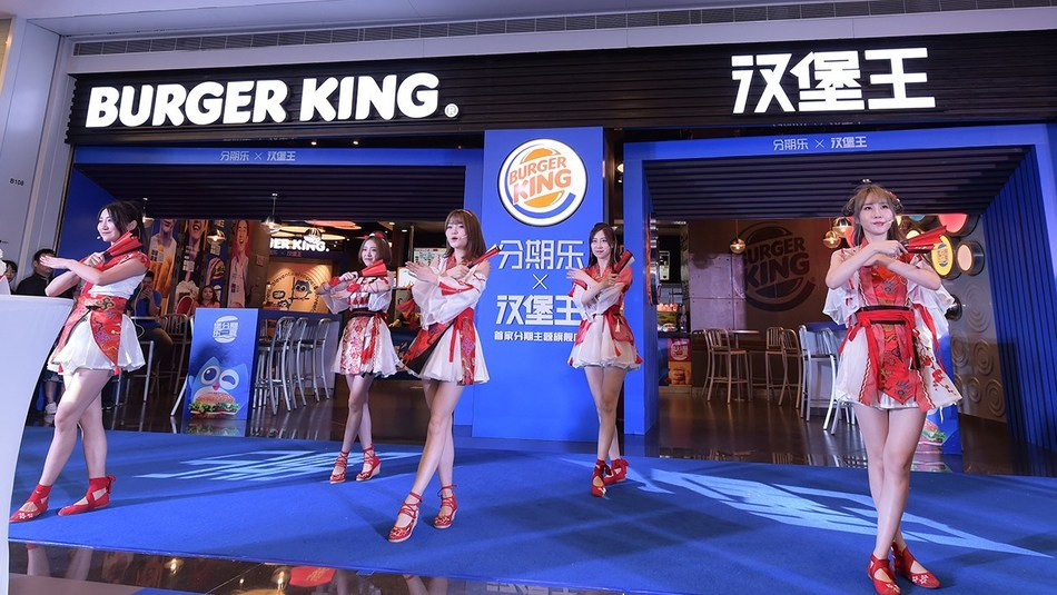 Popular girl group SING from the reality show Produce 101 performing during the opening ceremony of the campaign at a Burger King store in Shenzhen, China.