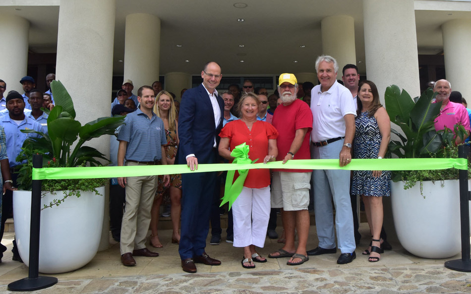CLUB WYNDHAM owners Renee and Bill Binkley (center, in red) cut the ribbon to officially reopen the Margaritaville Vacation Club resort in St. Thomas with Wyndham Destinations President and CEO Michael D. Brown (left) and Margaritaville President of Development Jim Wiseman (right).