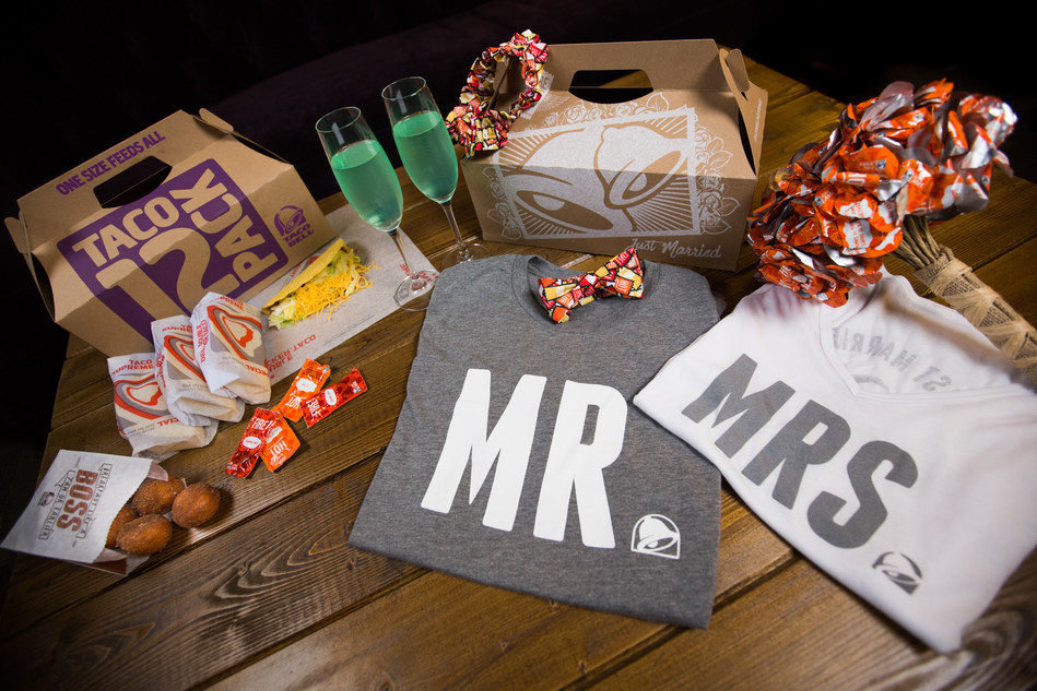 """Taco Bell's wedding package includes a garter, bow tie, sauce packet wedding bouquet, """"Just Married"""" t-shirts, Taco Bell champagne flutes, a Cinnabon Delights® Wedding Cake, and, of course, a Taco 12 Pack. Now, wedding attire and accessories are also available online in Taco Bell's Taco Shop, so that fans can make Taco Bell part of their wedding festivities no matter where they are located."""