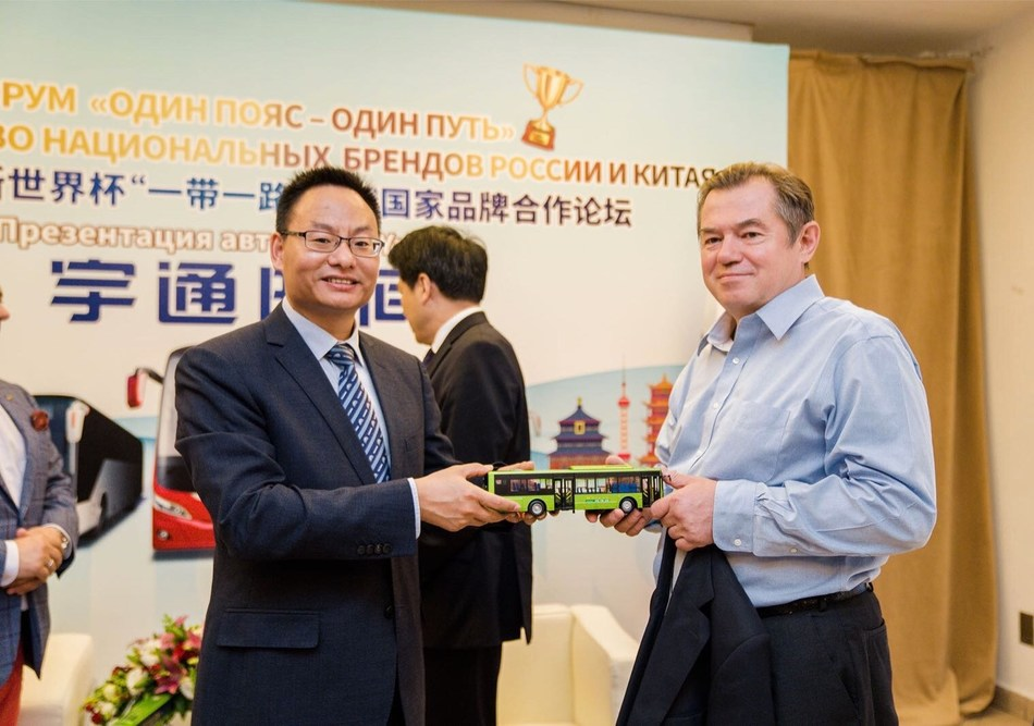 Hu Huaiban (left), General Manager of International Business of Yutong Bus, gives Yutong bus model as present to Sergey Glaziev (right), advisor to the president of the Russian Federation