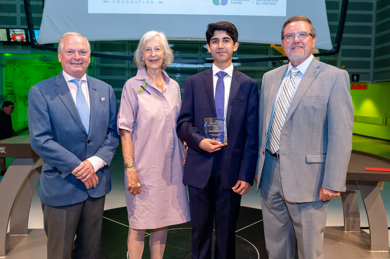 Today, the Ontario Science Centre presented the 2018 Weston Youth Innovation Award to London, Ontario's Danish Mahmood for his Wireless Interconnected Non-Invasive Triage System (WINITS) device. Established in 2008, the Award encourages and recognizes young Canadian innovators.  L-R: Geoffrey Wilson (The W. Garfield Weston Foundation), Nancy Rebanks (The W. Garfield Weston Foundation), Danish Mahmood and Maurice Bitran (Ontario Science Centre) (CNW Group/Ontario Science Centre)